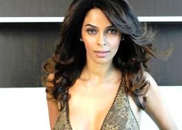 Mallika locks lips with reality show contestant