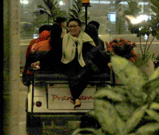 Rani with her baby Adira at the airport