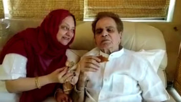Saira Banu plants a sweet kiss on Dilip Kumar's cheek while having a cup of tea
