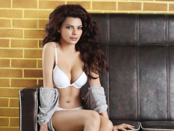 SEXY KITTEN! Sherlyn Chopra OOZES SEX in this bikini photoshoot!