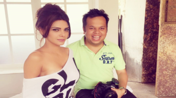 Sherlyn Chopra posing in nothing but an off shoulder tee