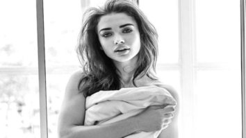 Amy Jackson covered in a bedsheet