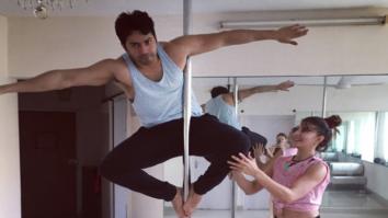 Varun Dhawan learns pole dancing from Jacqueline Fernandez