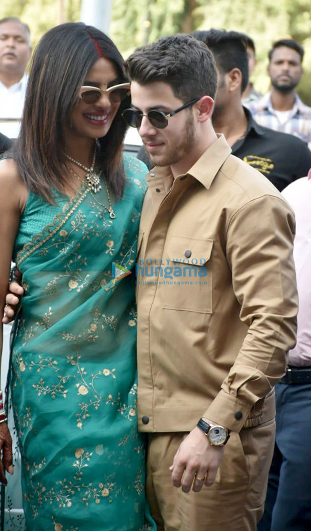 FIRST PHOTOS: Priyanka Chopra is a stunning new bride while posing with husband Nick Jonas at the Jodhpur airport